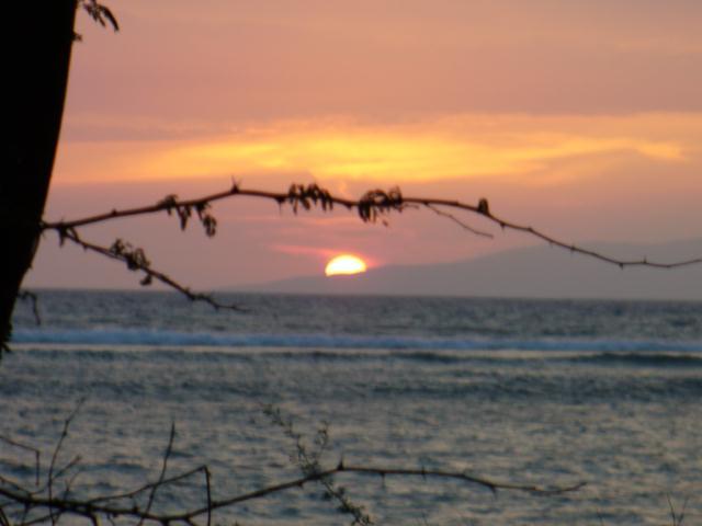 Sun setting behind Lanai